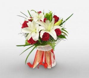 Scented Lilies And Vibrant Red Roses For Mom