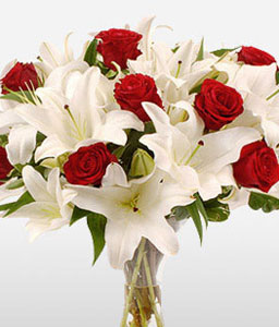 Fire And Ice <Br><Font Color=Red>Combination of White Lilies & Red Roses</Font>
