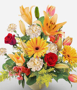 Exotic Lushes-Mixed,Orange,Red,White,Tulip,Rose,Mixed Flower,Lily,Gerbera,Carnation,Arrangement