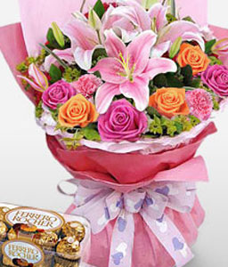 Carnival Of Color-Orange,Pink,Rose,Mixed Flower,Lily,Chocolate,Carnation,Hamper