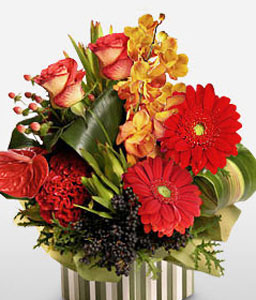 Magic Box-Peach,Red,Yellow,Anthuriums,Carnation,Daisy,Gerbera,Mixed Flower,Orchid,Rose,Arrangement